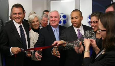 Governor Deval Patrick and Dr. Susan Windham-Bannister, President of the Massachusetts Life Sciences Center, attend the opening of Biocell Center's North American Headquarters. Pictured left to right are Marco Reguzzoni, Chairman of Biocell Center, Senator Pat Jehlen, Medford Mayor Michael McGlynn, Governor Deval Patrick, Dr. Susan Windham-Bannister, MassBio President & CEO Bob Coughlin, and Kate Torchilin, CEO of Biocell Center.