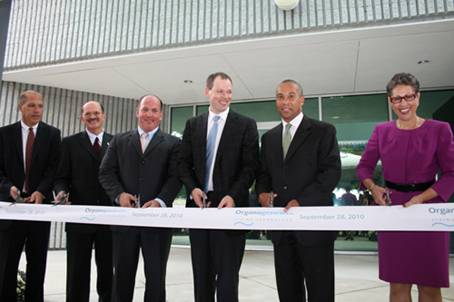 Photograph of Governor Deval Patrick and Dr. Susan Windham-Bannister, President and CEO of the Massachusetts Life Science Center, attending the Organogenesis' new facility in Canton.